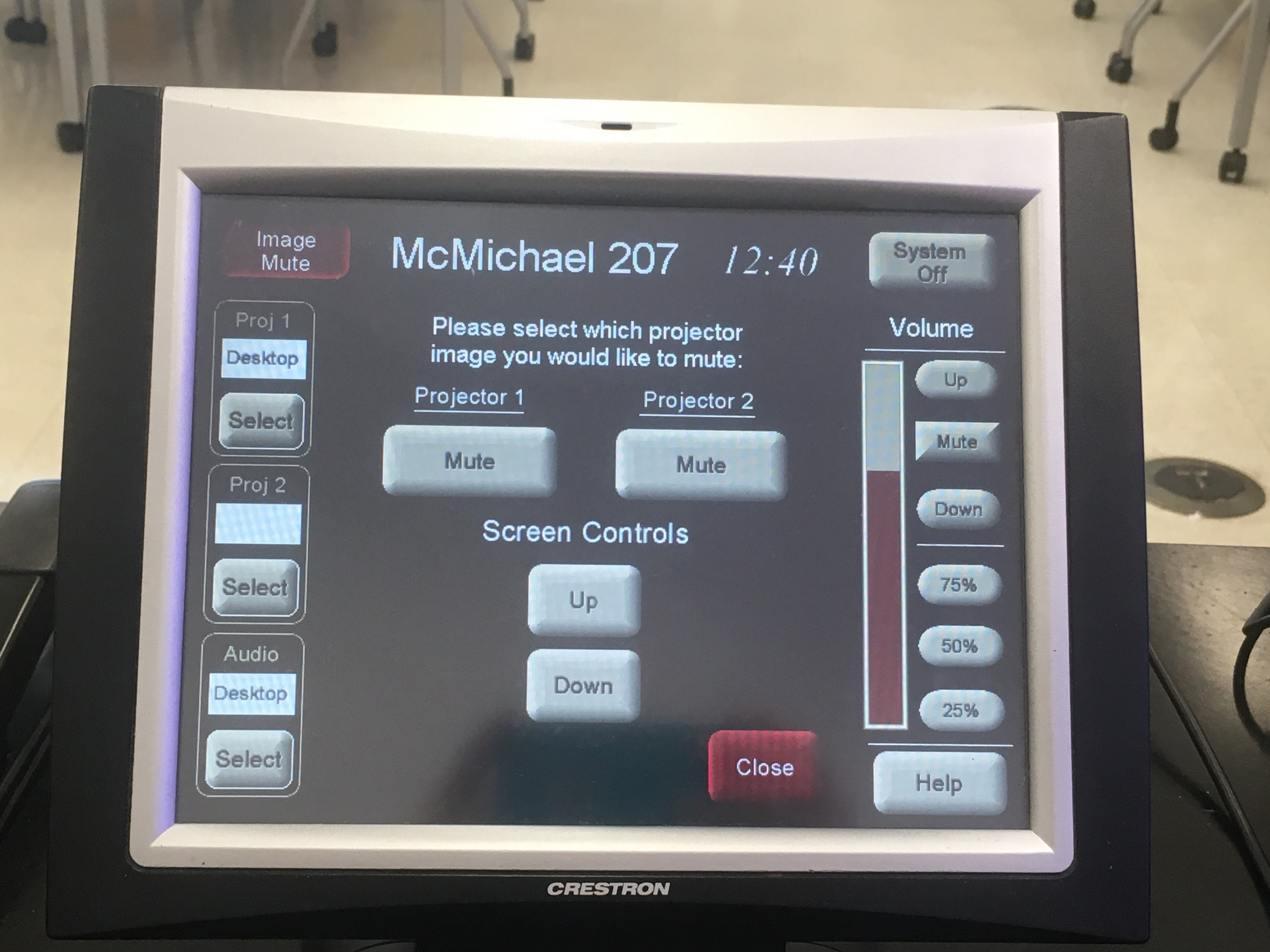 Photo of the crestron control touch panel with the the image mute option selected