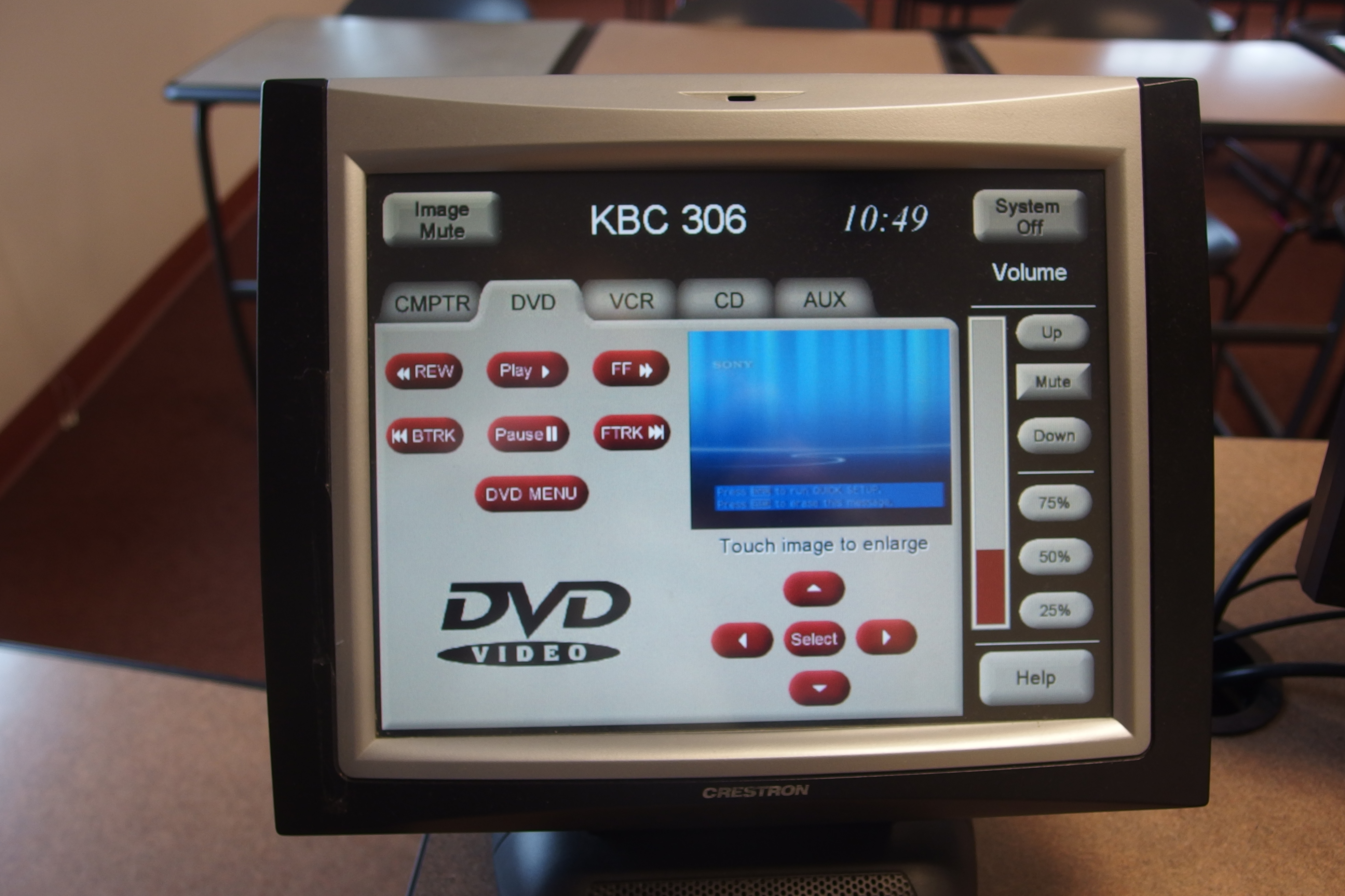 Photo of crestron control touch panel with the dvd tab active