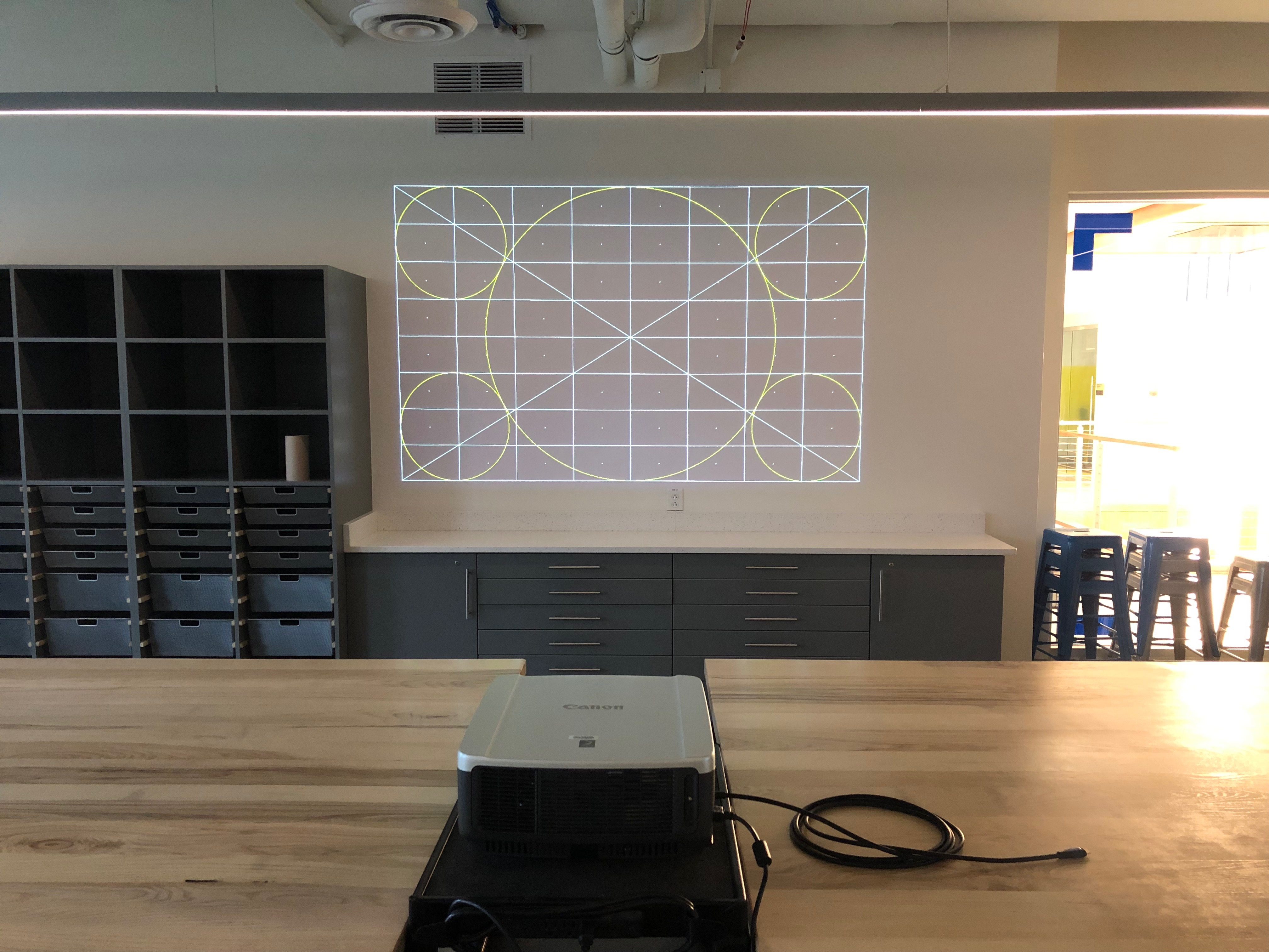 A photo of the projector from the back facing the wall.