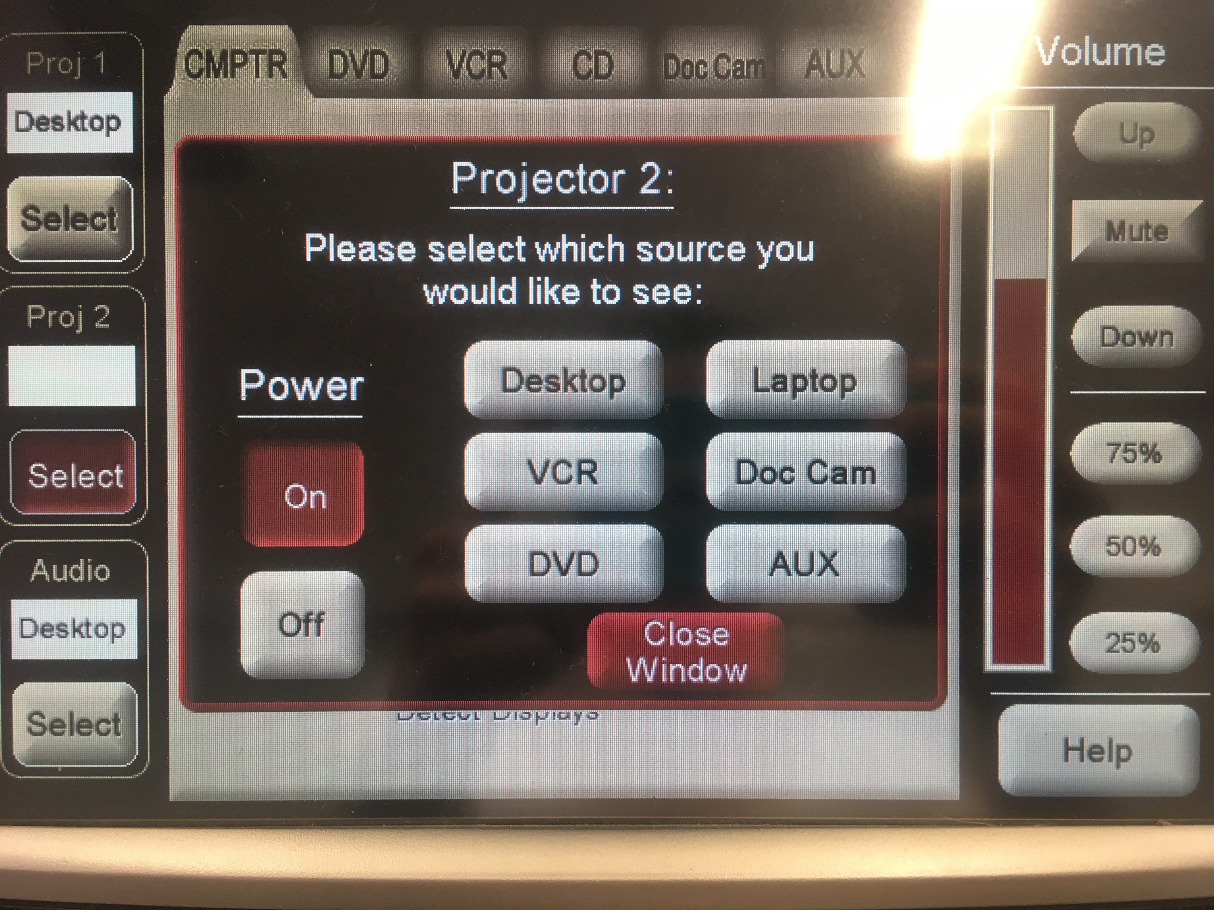 Photo of the crestron control touch panel showing the option to turn projector 2 on