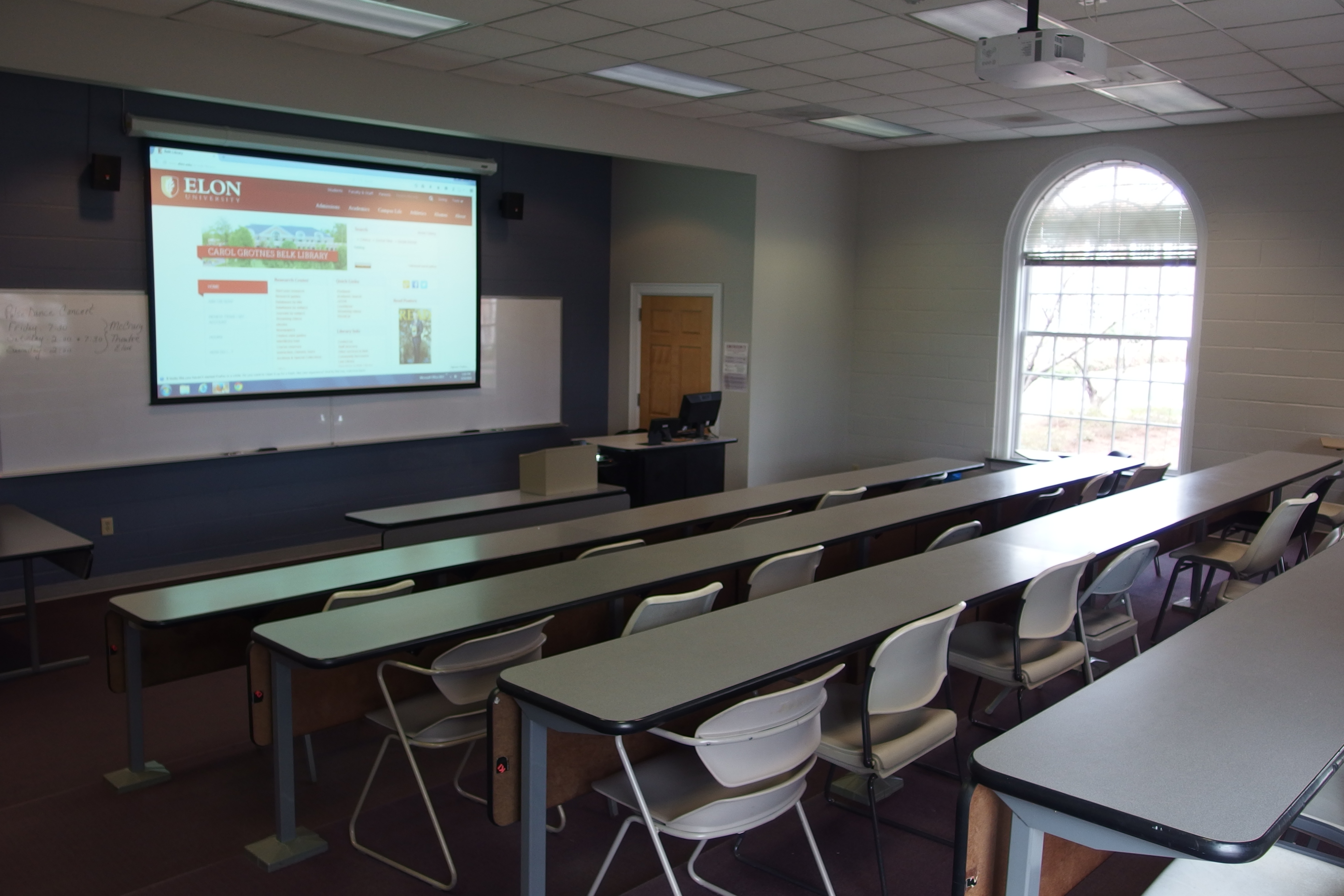 Photo of the classroom space taken from the back of the room looking towards the instructor's station