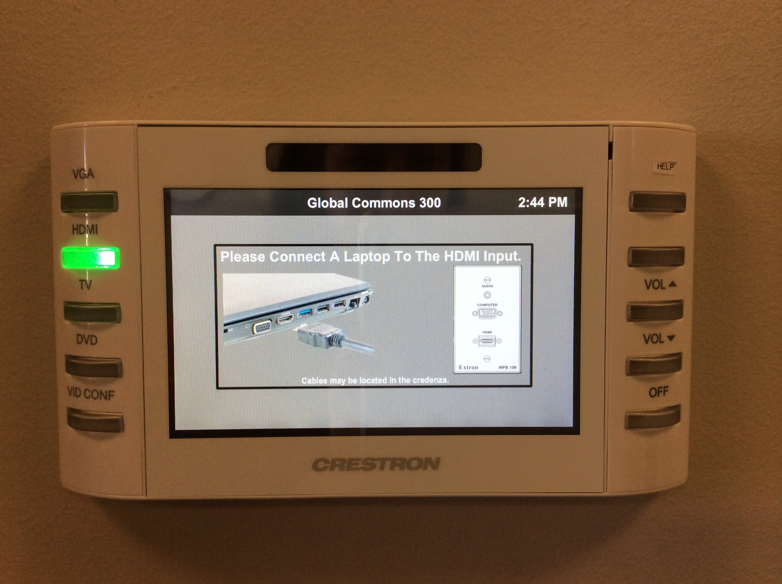 Photo of crestron control touch panel with hdmi option active