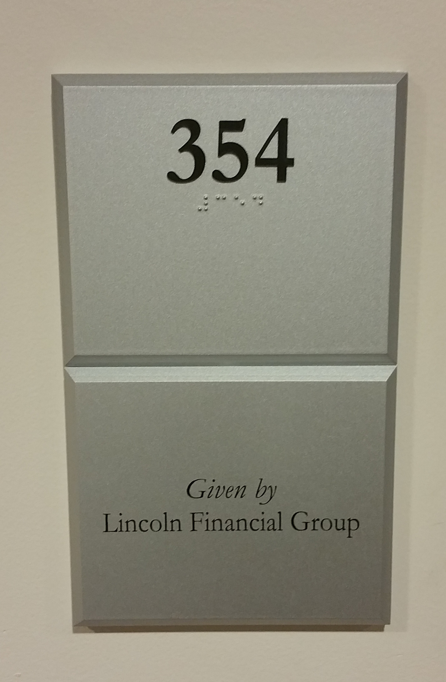 Photo of Koury Business Center 354 room number with dedication plaque installed below