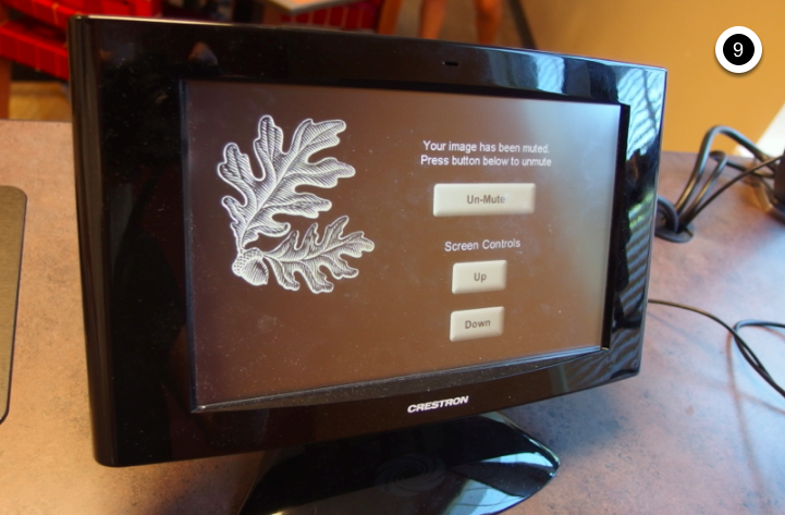 Photo of crestron control touch panel with image mute or un-mute screen active
