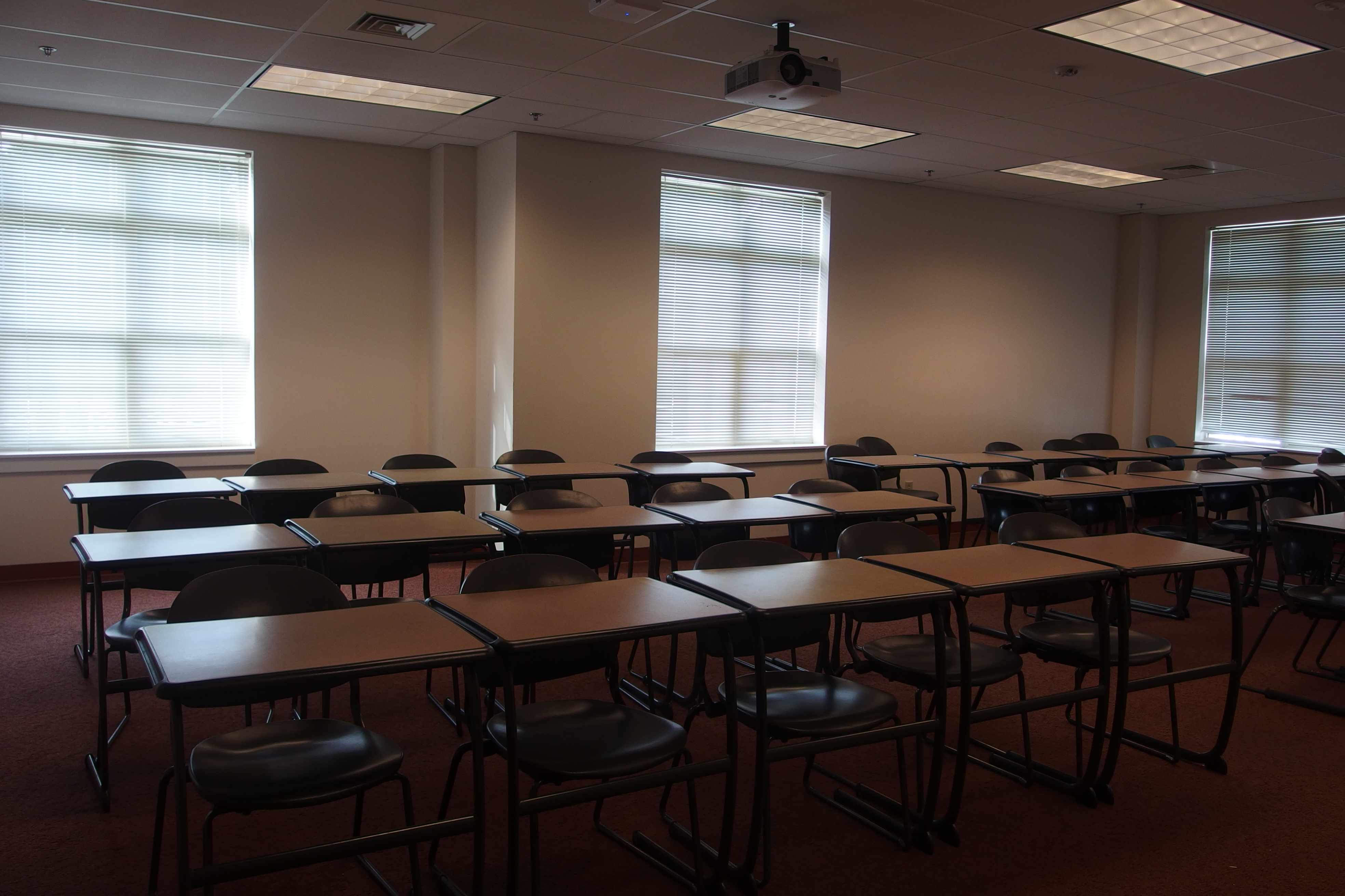 Photo of the classroom taken from the entrance of the room showing the student tables