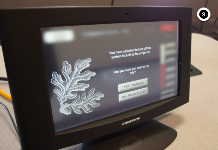 Photo of crestron control touch panel displaying the shutdown screen