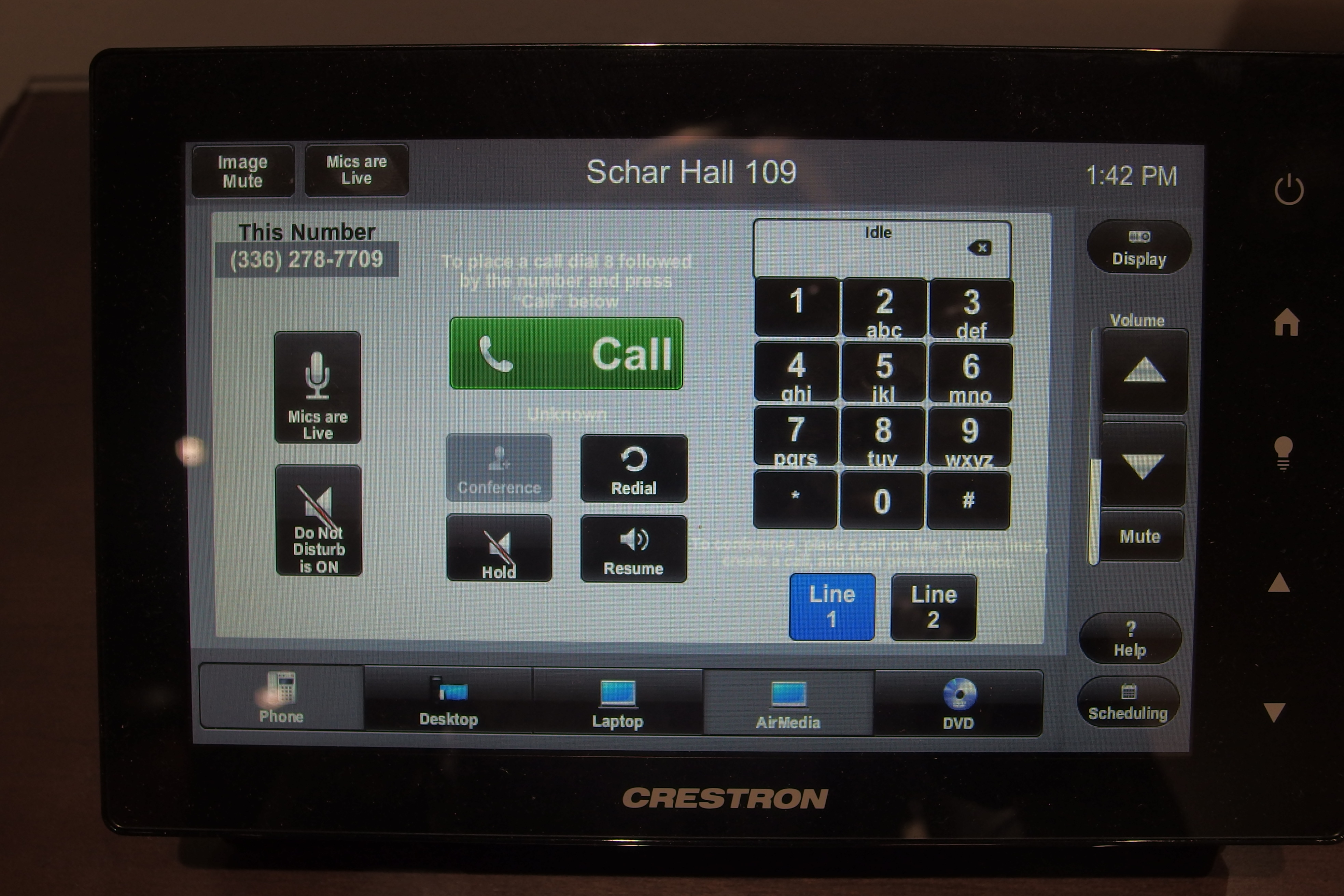 A photo of the touch panel showing the phone page.