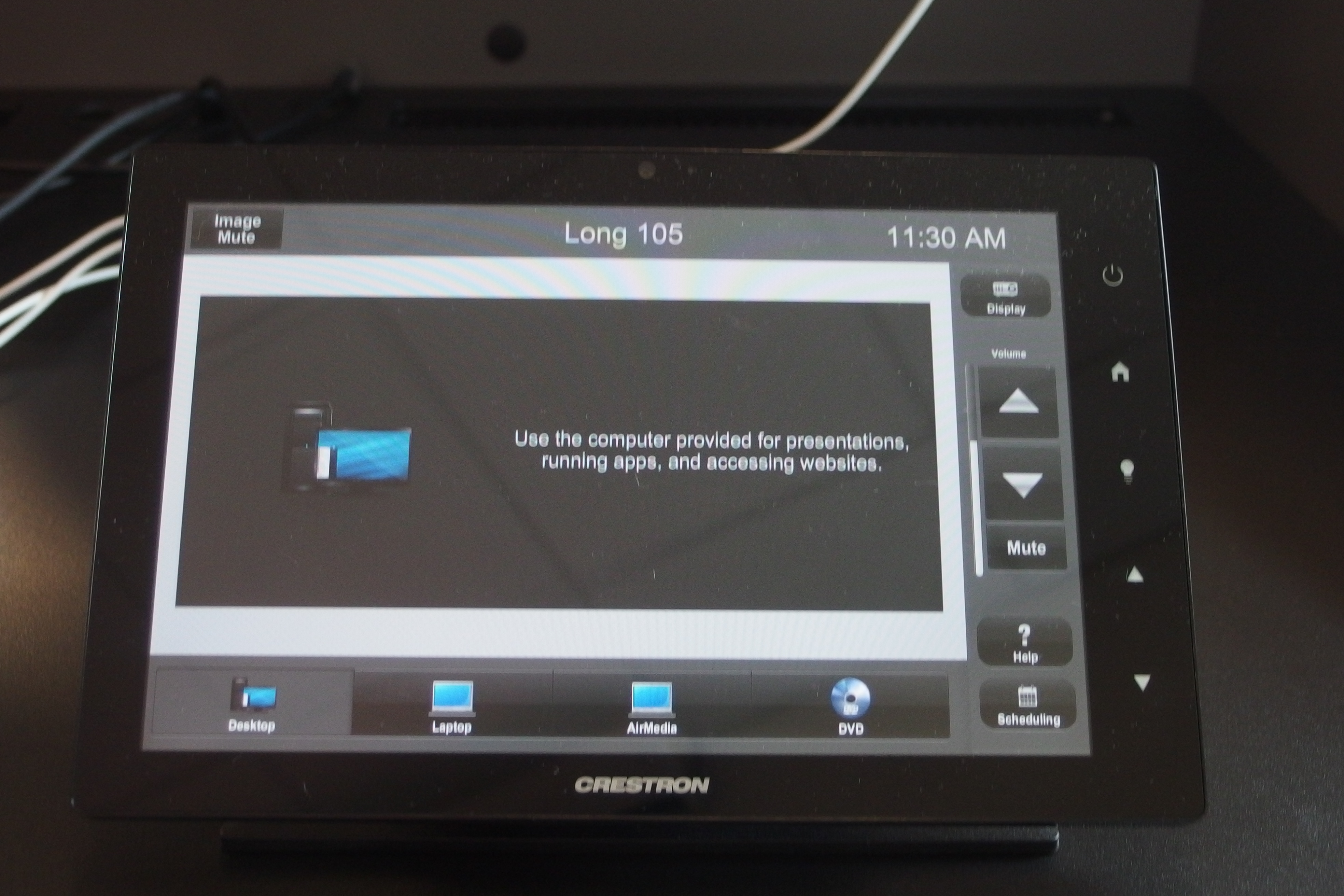 Photo of crestron control touch panel with the desktop tab active