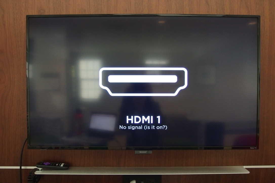 A picture of Sharp Roku TV on the HDMI window.
