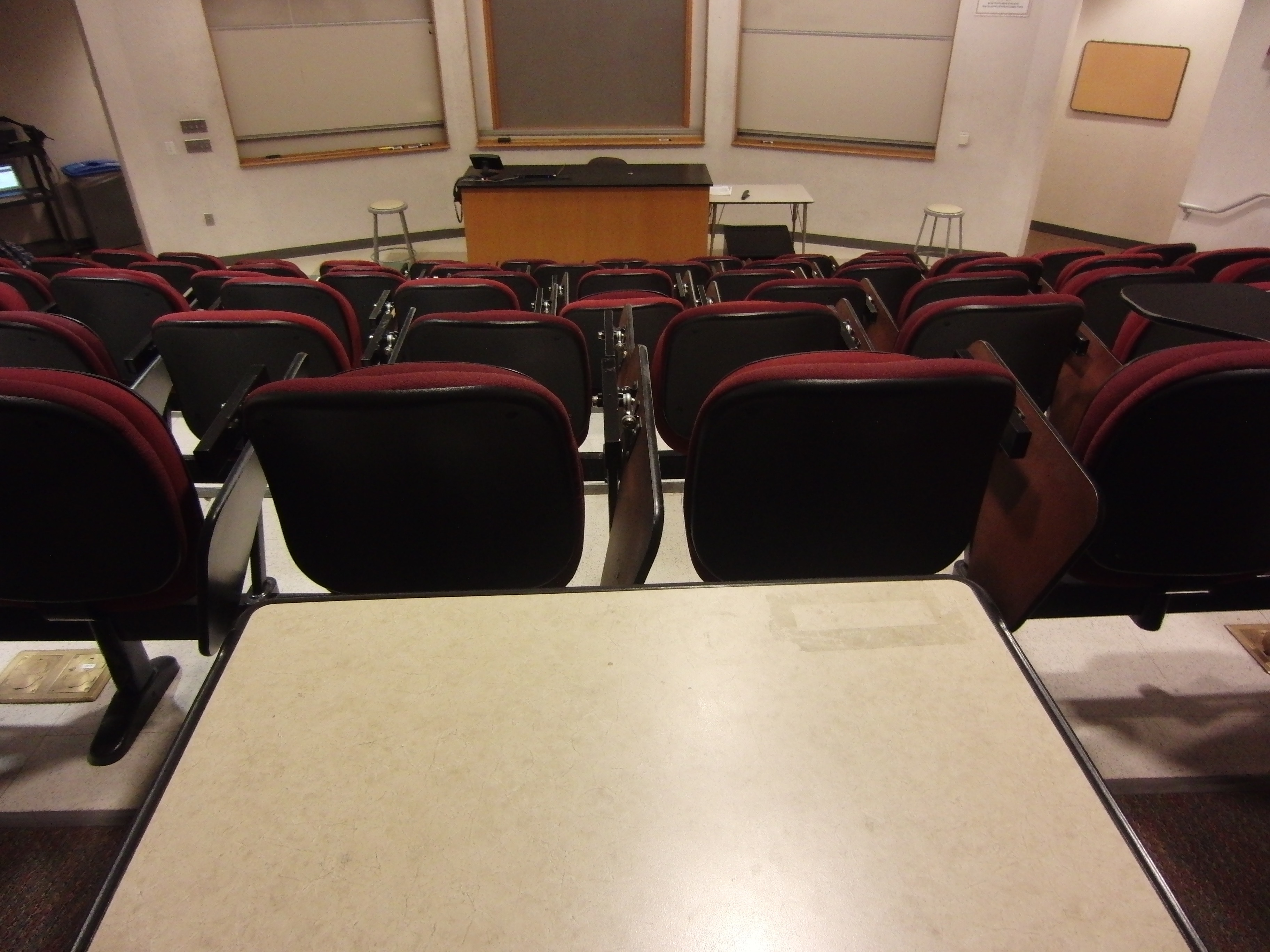 Photo of the lecture room looking from the upper part of the room towards the front stage area