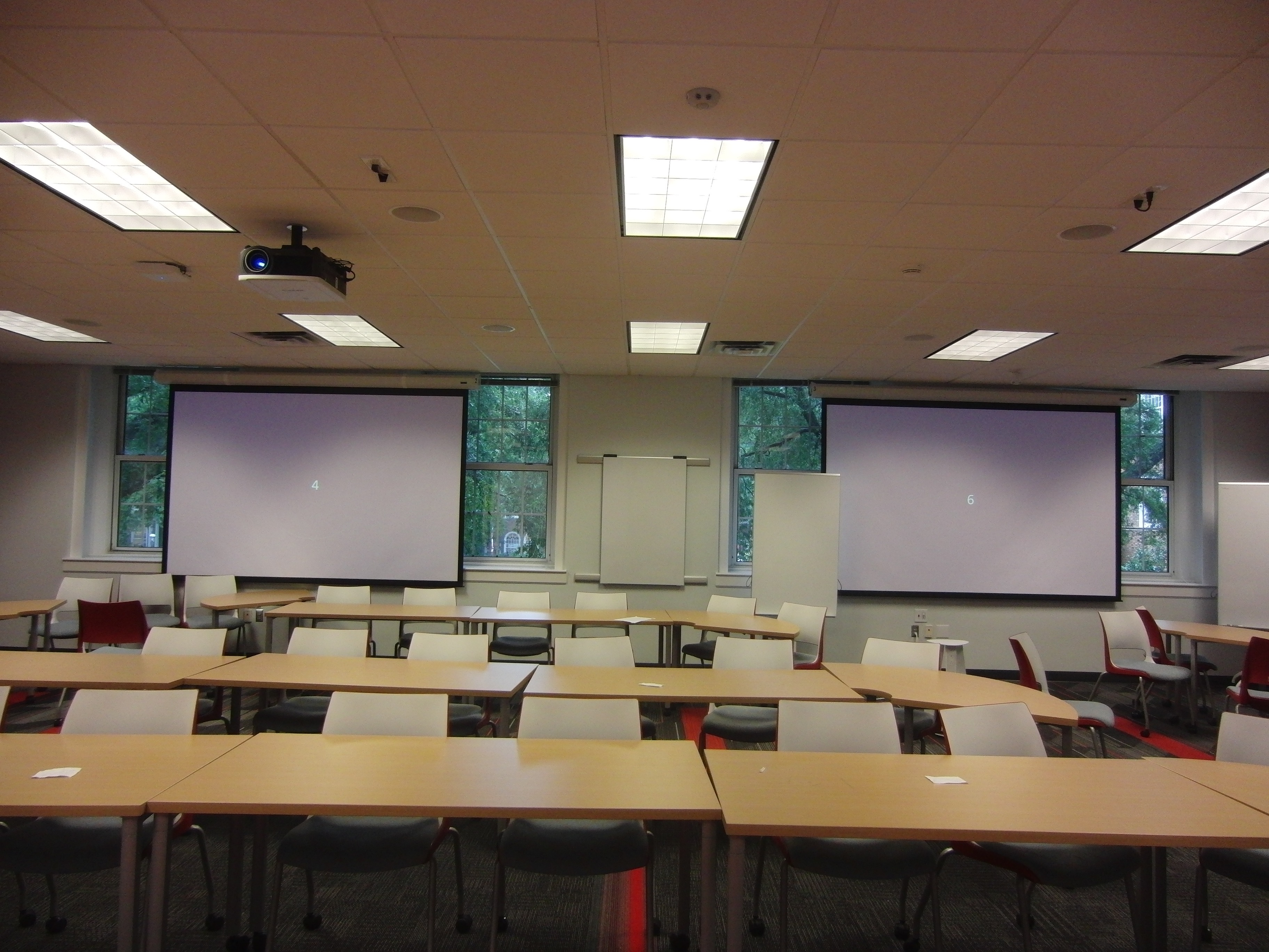 Photo taken from the front center of the room directly to the back center with both projection screens lowered