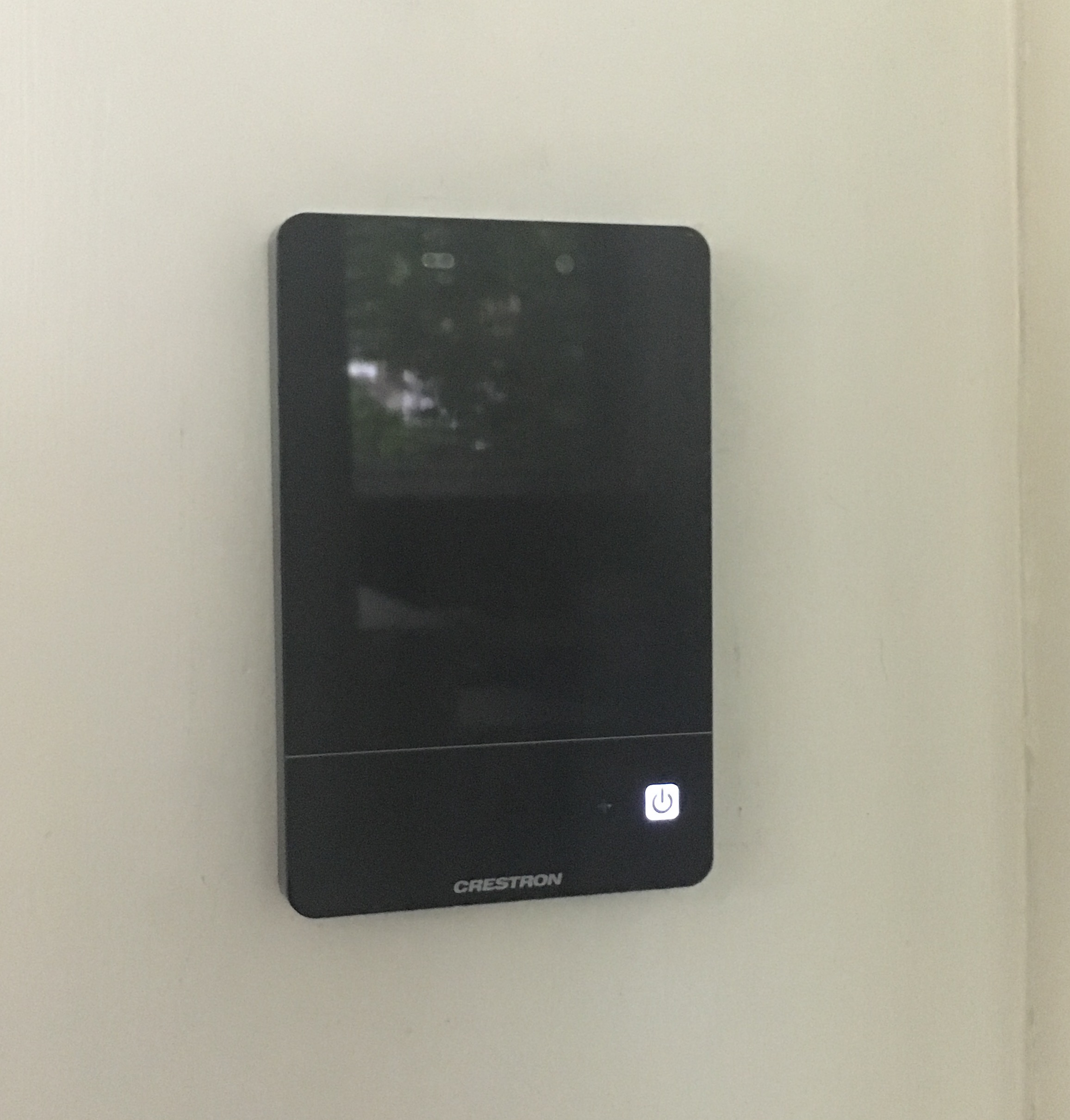 Picture of Crestron touch panel located below the flat panel display.