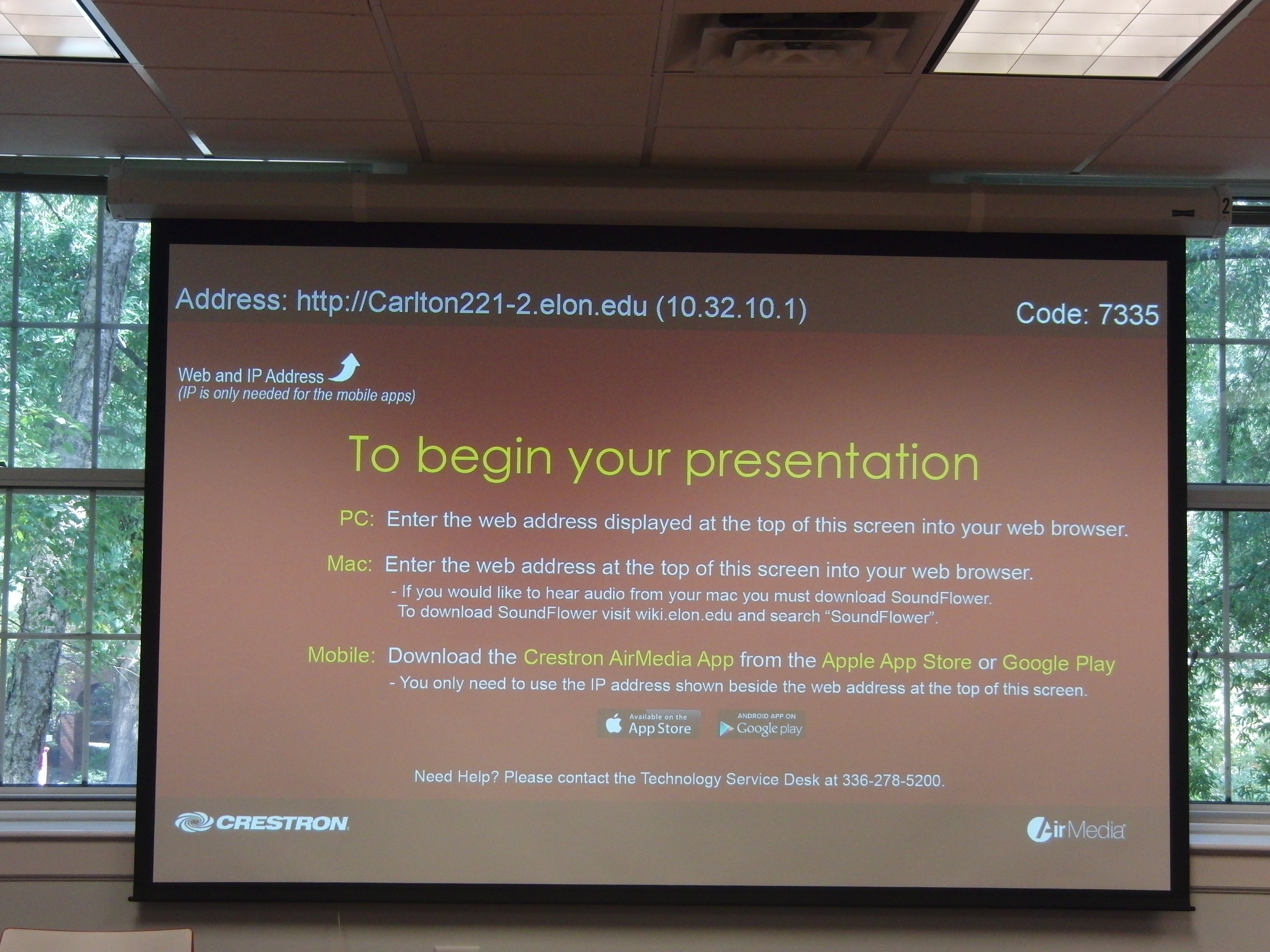 Photo of projection screen noting AirMedia application install information