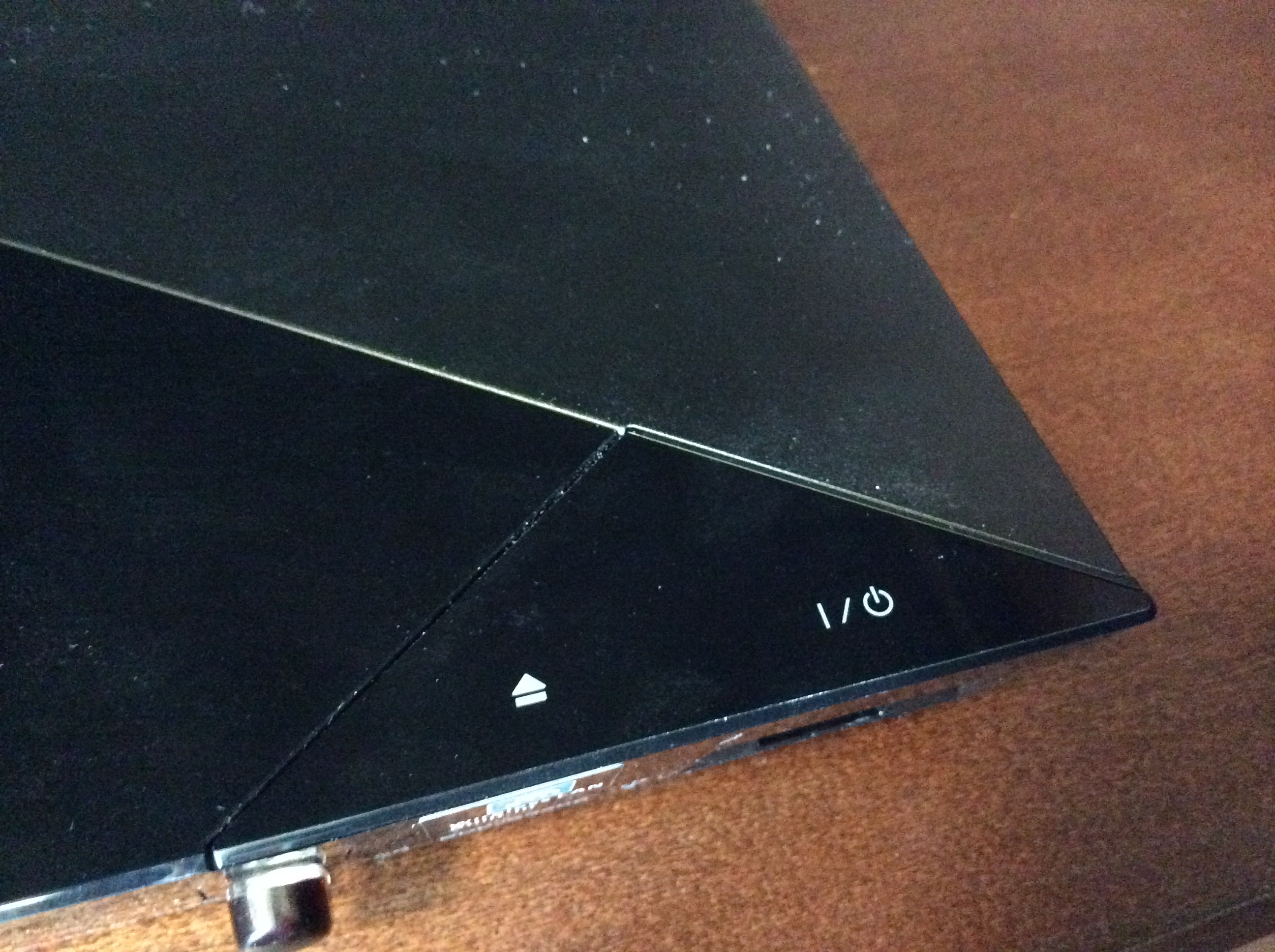 Photo of on, off, and eject option for the dvd player