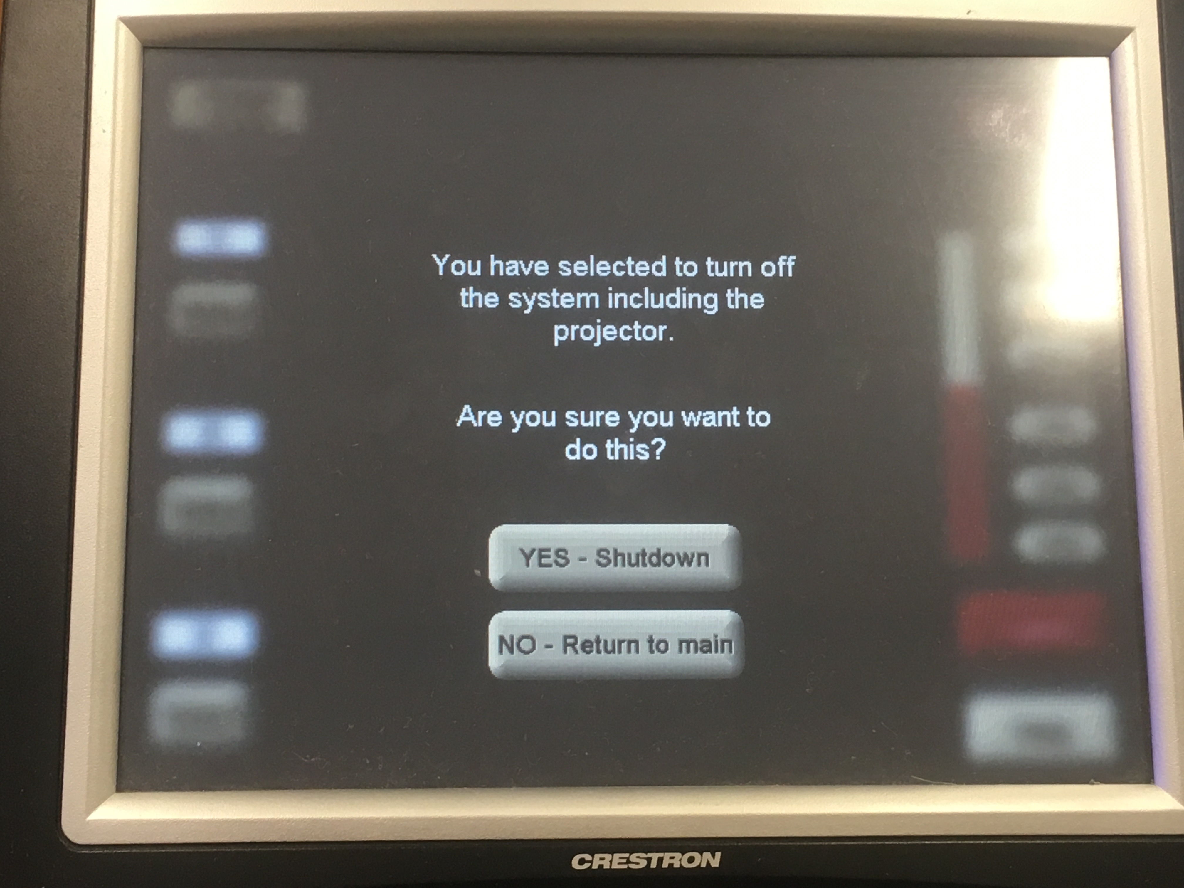 Photo of crestron control touch panel displaying the shutdown option