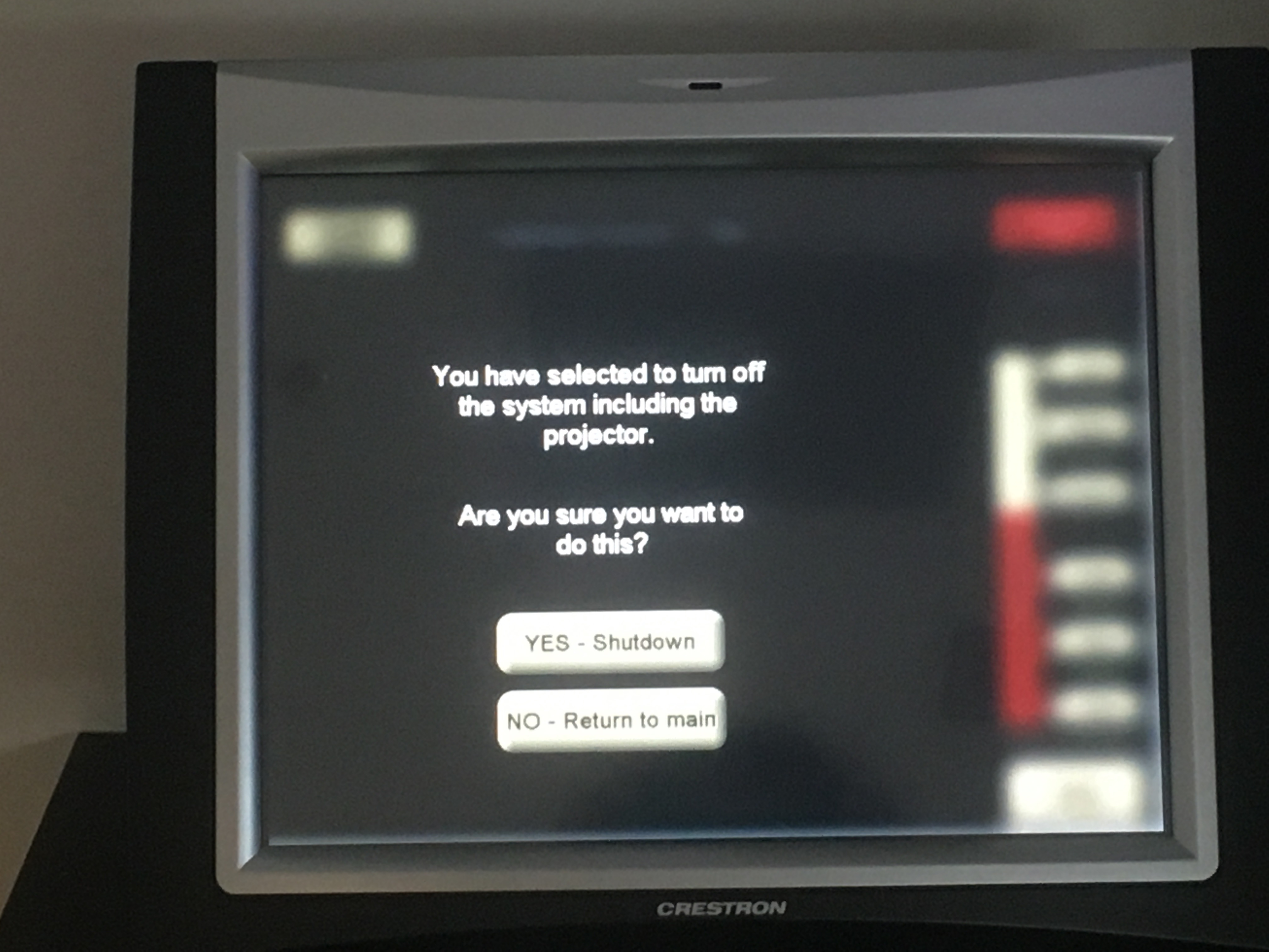 Photo of the crestron control touch panel showing the option to shutdown the system