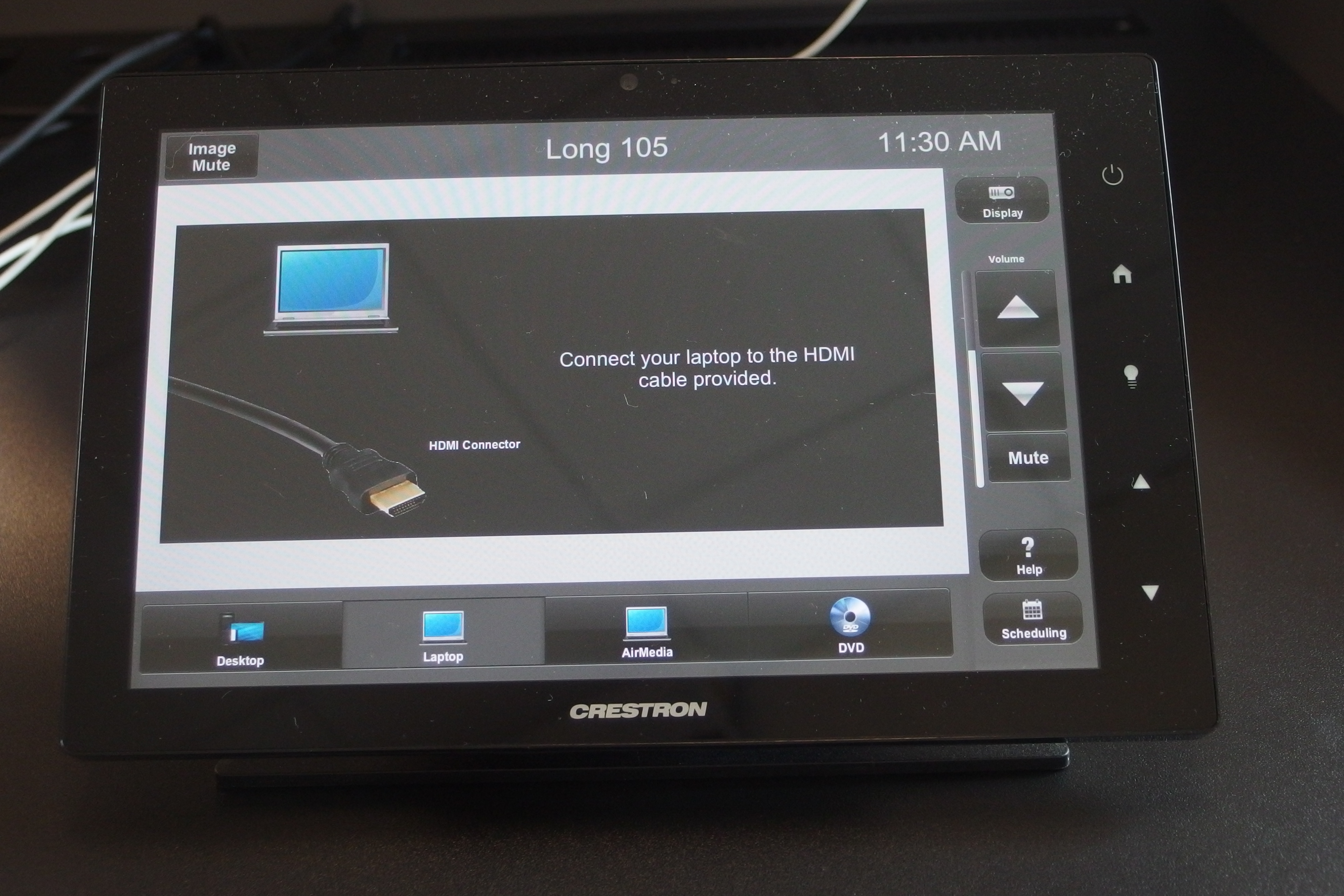 Photo of crestron control touch panel with the laptop tab active