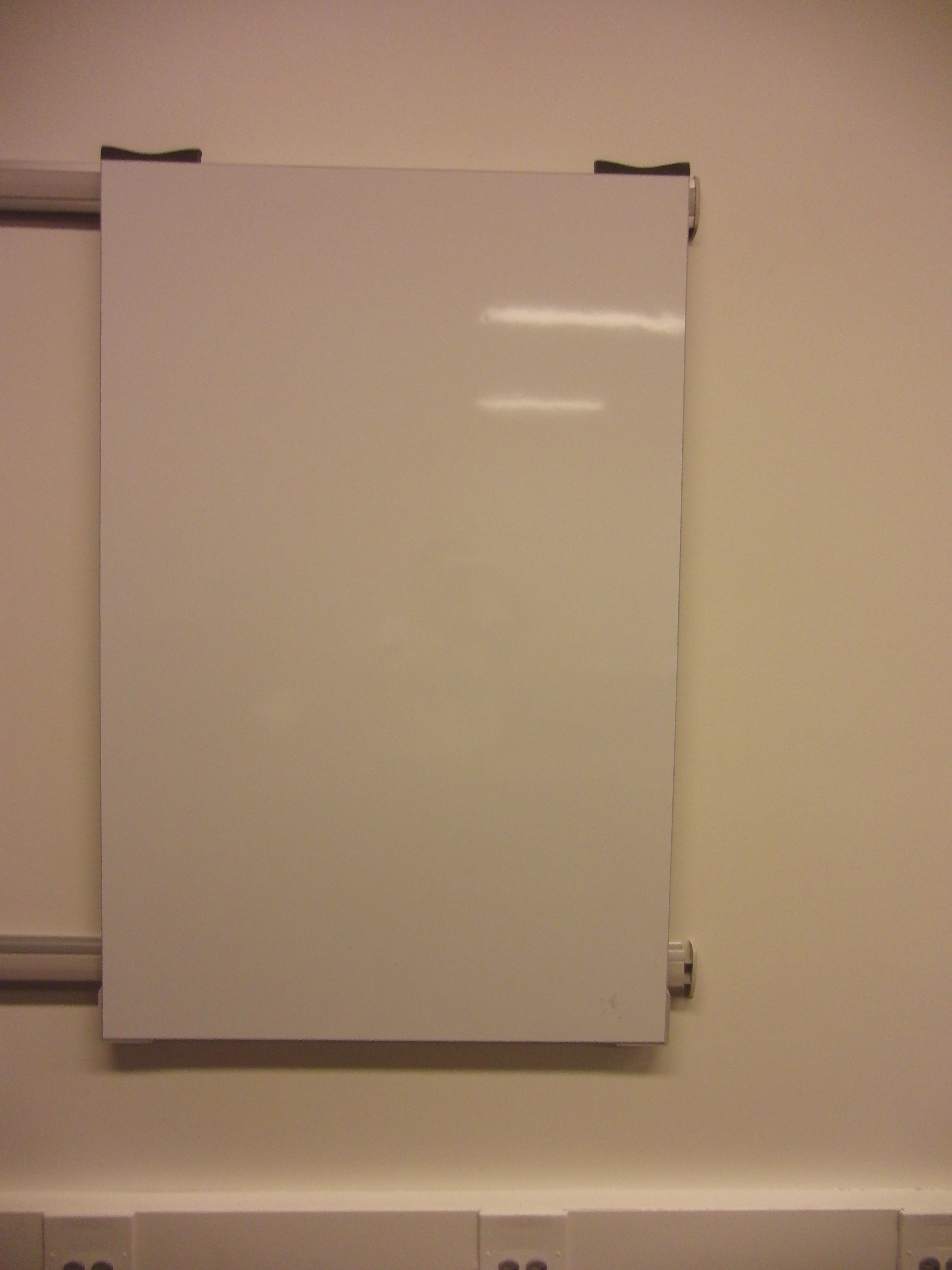 Photo of one of the moveable whiteboards installed in the space