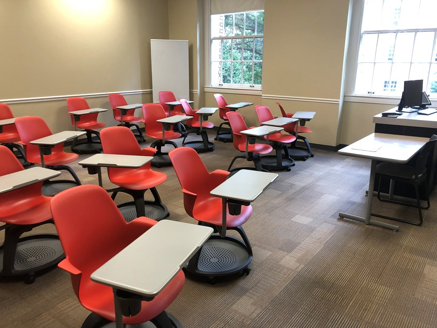 Photo of the classroom taken from the entrance that shows student desks and instructor's station
