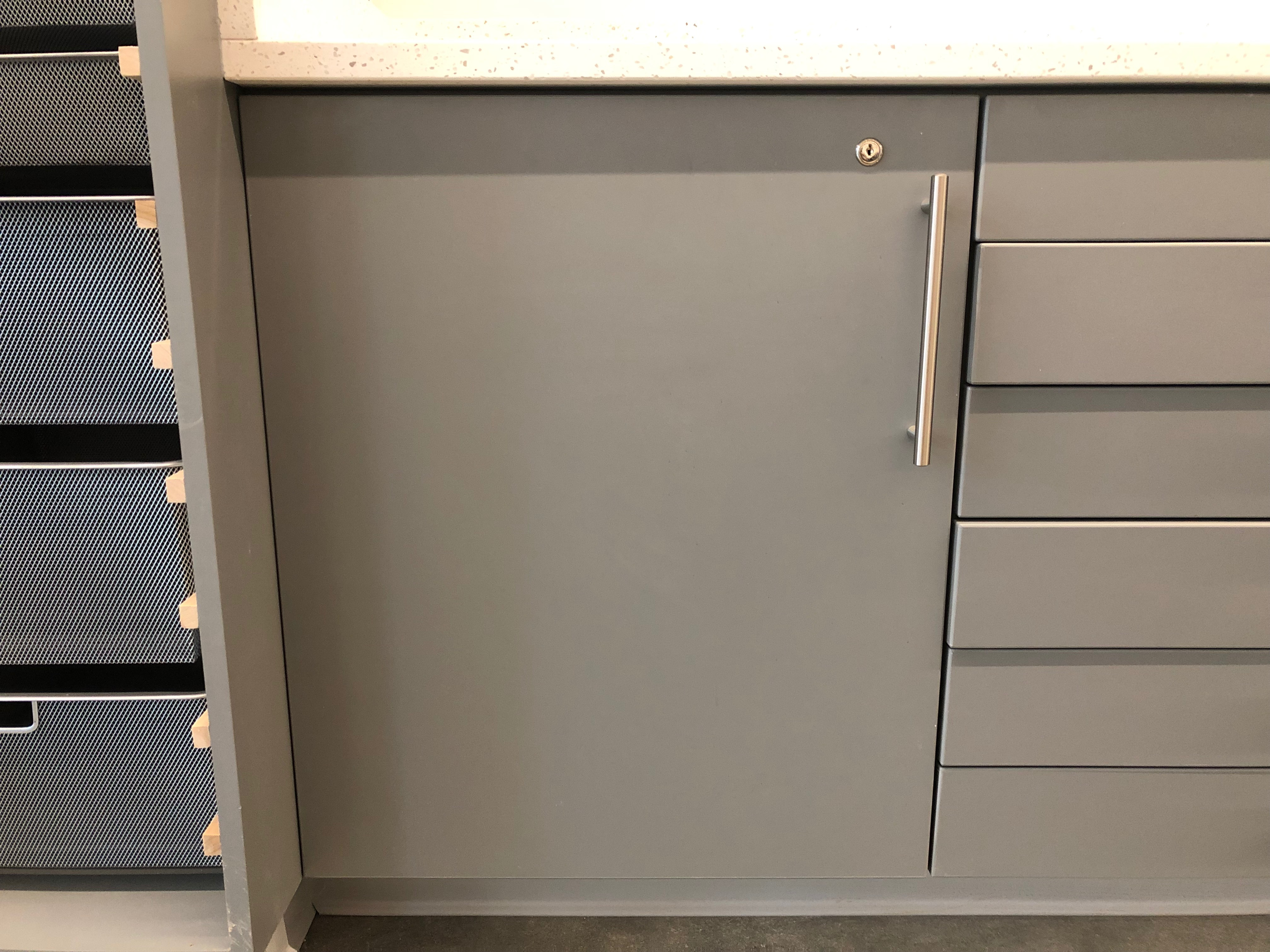 A photo of the projector storage cabinet from the front.