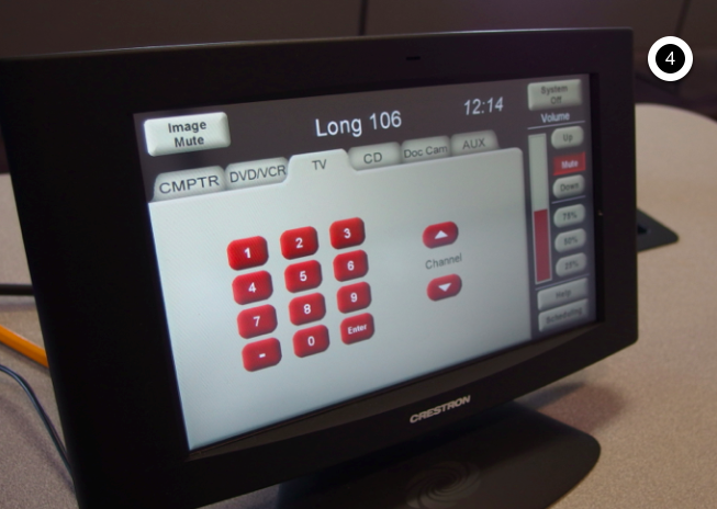 Photo of crestron control touch panel with the TV tab active