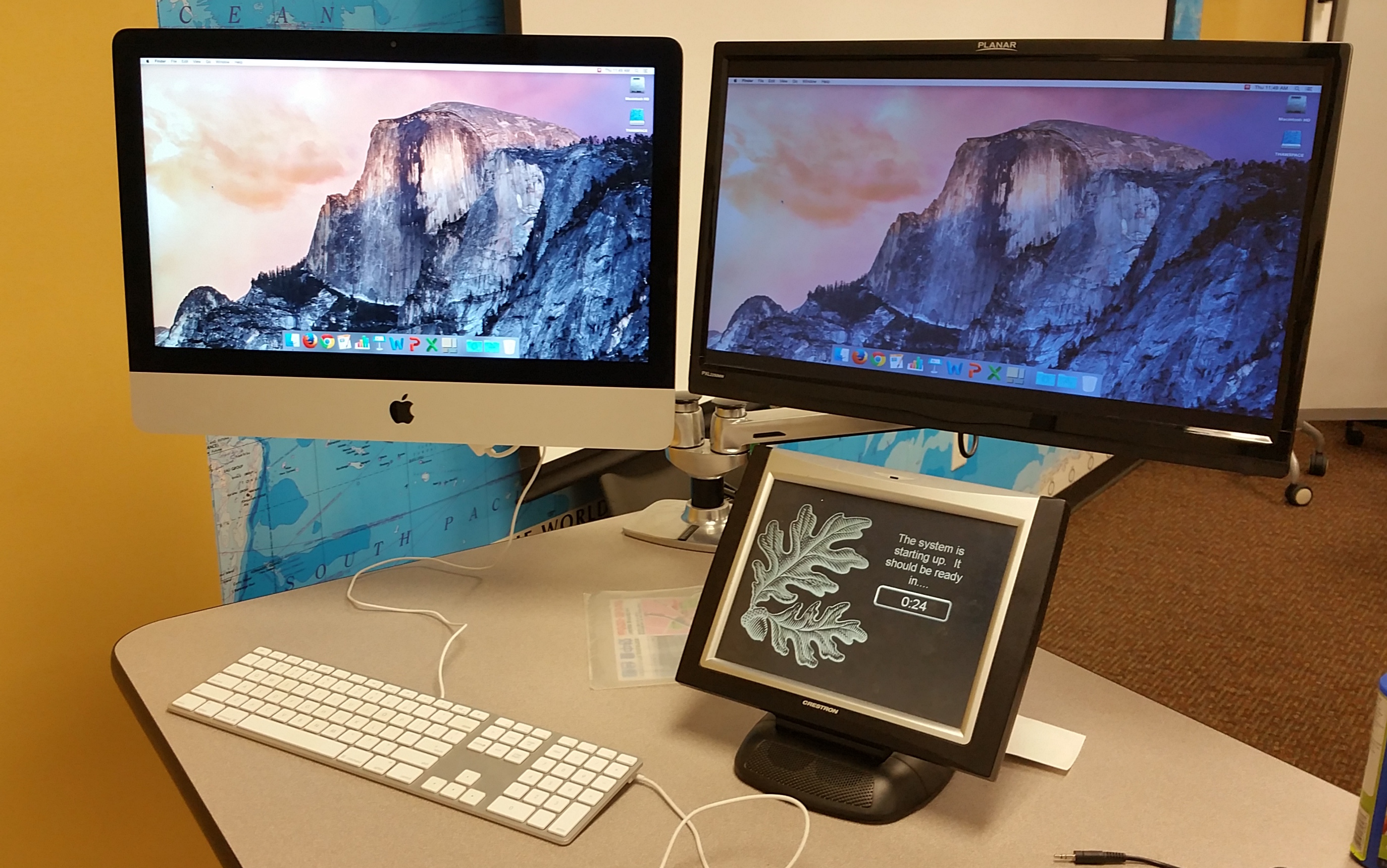 Photo of the Apple desktop setup on the instructor's station with attached Planar screen