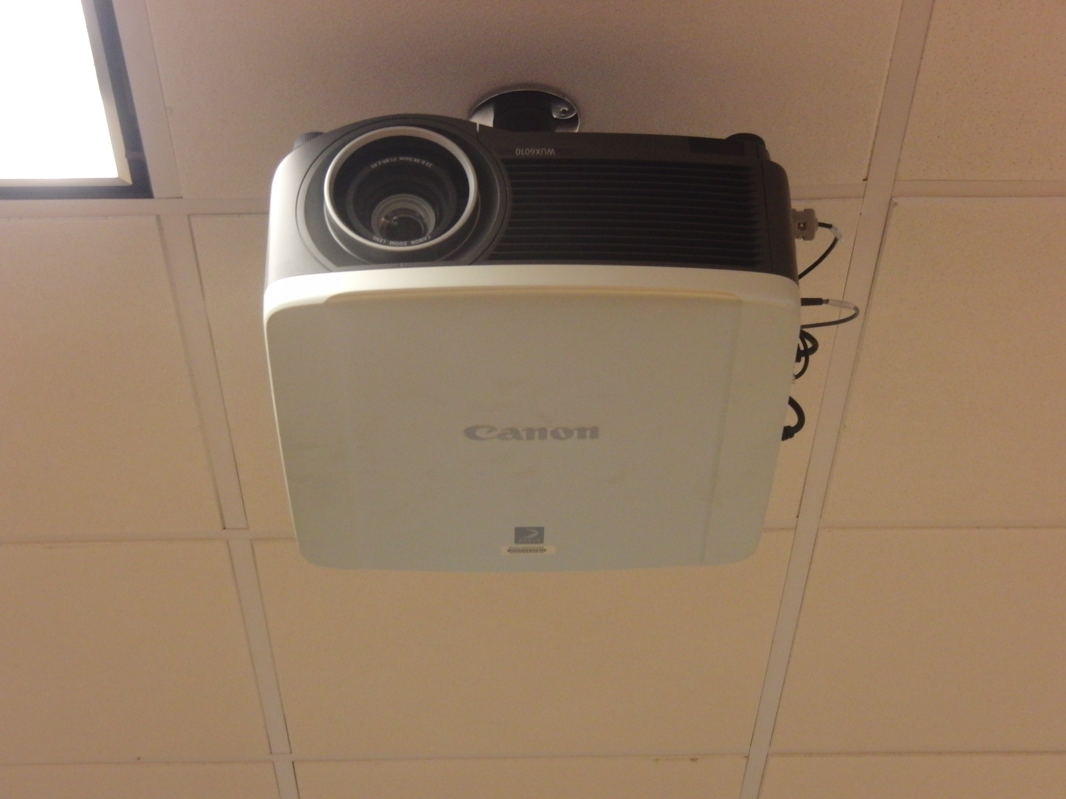 Photo of a canon projector installed in the room