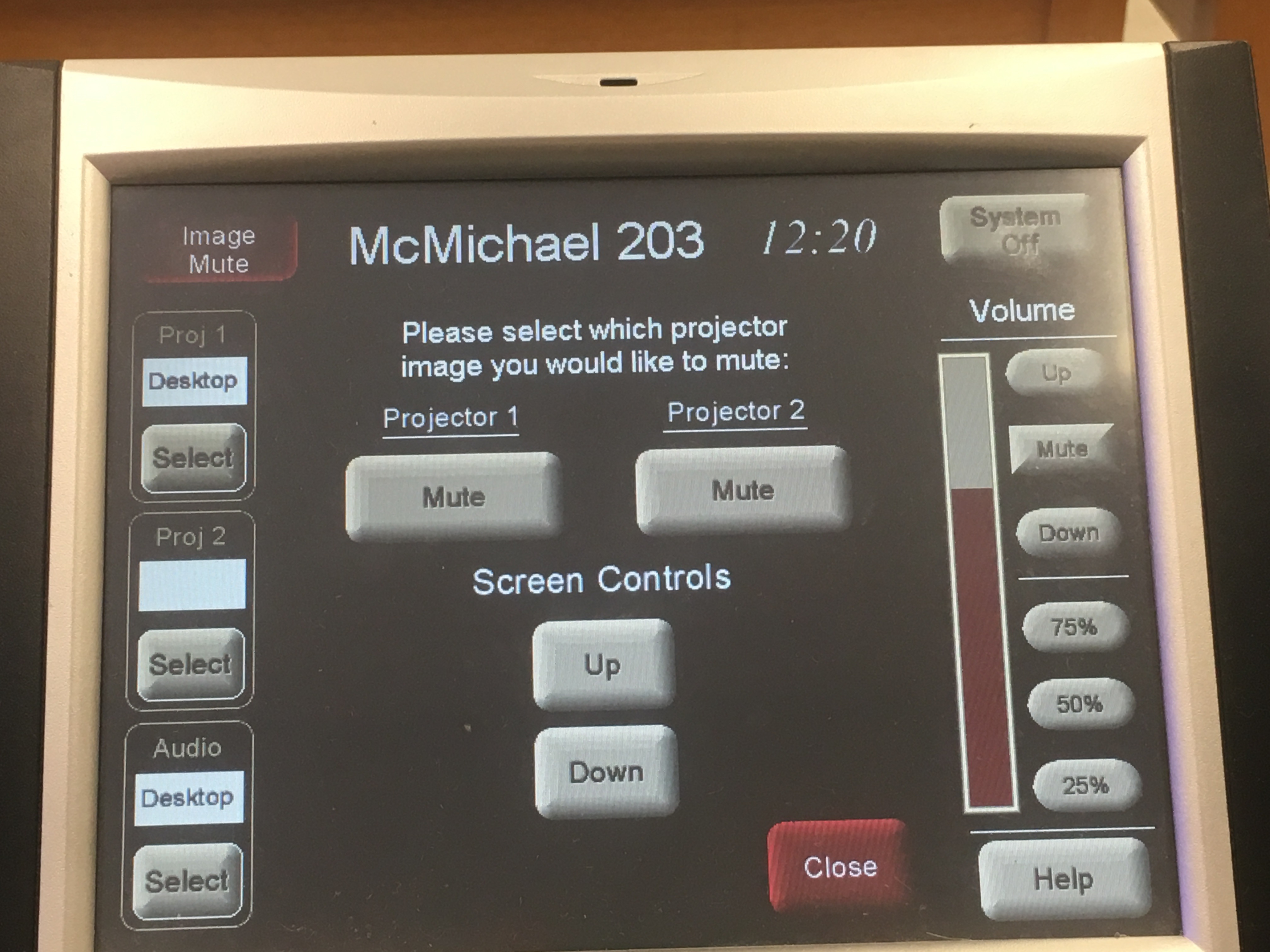 Photo of crestron control touch panel with the option to mute the projector 1 or projector 2 as well as raise and lower the screen