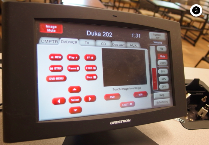Photo of crestron control touch panel with DVD/VCR tab active
