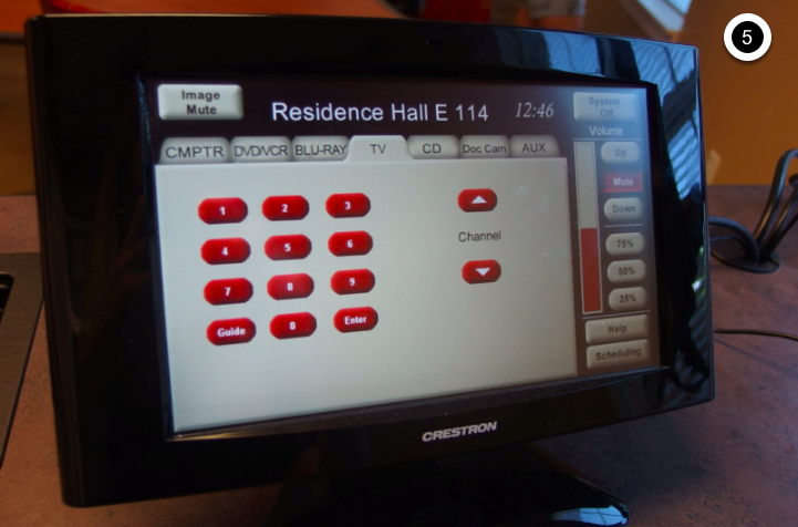 Photo of crestron control touch panel with TV tab active